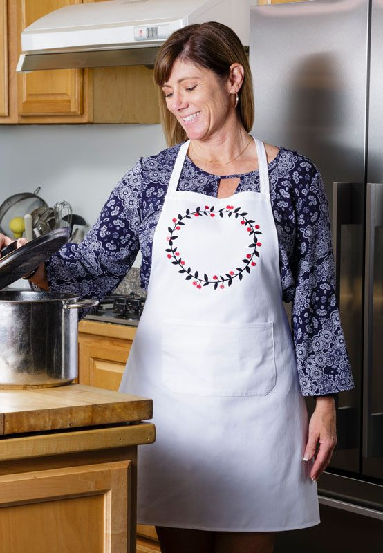 Iron on a design onto a plain apron for a great gift from Craft Warehouse