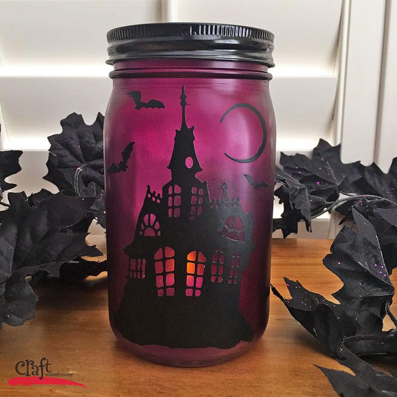 Make this Haunted House Mason Jar Luminary