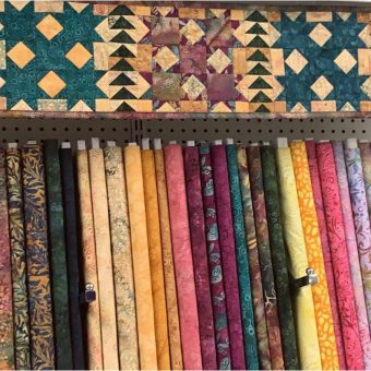 Table Runner display at the Medford Quilt Shop in Craft Warehouse